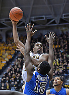 WICHITA, KS - JANUARY 18:  Forward Darius Carter #12 of the Wichita State Shockers scores over forward Demetrius Moore #15 of the Indiana State Sycamores during the second half on January 18, 2014 at Charles Koch Arena in Wichita, Kansas.  Wichita State defeated Indiana State 68-48. (Photo by Peter Aiken/Getty Images) *** Local Caption *** Darius Carter;Demetrius Moore