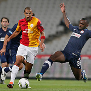 Istanbul BBSpor's Kamil ZAYATTE (R) and Galatasaray's Felipe MELO (L) during their Turkish soccer superleague match Istanbul BBSpor between Galatasaray at the Ataturk Olympic stadium in Istanbul Turkey on Sunday 11 September 2011. Photo by TURKPIX