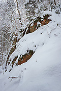 "Partly snow covered Sandstone cliff-face and snowy winter day in forest by ""Cīruļu iezis"", Gauja National Park (Gaujas Nacionālais parks), Latvia Ⓒ Davis Ulands   davisulands.com"
