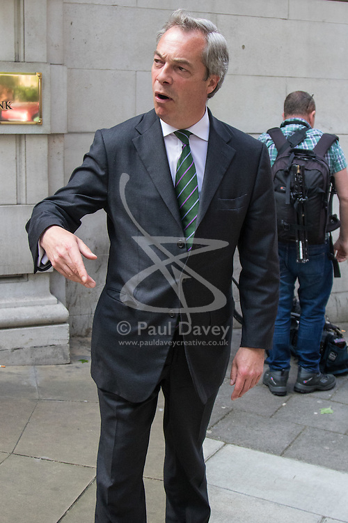 Milbank, London, May 12th 2016.  UKIP leader Nigel Farage leaves Milbank following a television interview as part of the Vote Leave campaign. ©Paul Davey<br /> FOR LICENCING CONTACT: Paul Davey +44 (0) 7966 016 296 paul@pauldaveycreative.co.uk
