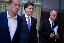 © London News Pictures. 25/09/2013 . Brighton, UK. Labour Party Leader ED MILIBAND arriving at the The Brighton Centre with his press team to give interviews to television and radio the morning after delivering his Keynote speech at the Labour Party Conference. Photo credit : Ben Cawthra/LNP