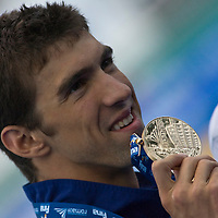 Michael Phelps (USA) celebrates his victory in 100 Men's Butterfly swimming competition during the 13th FINA Swimming World Championships held in Rome, Italy. Friday, 31. July 2009. ATTILA VOLGYI