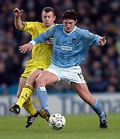 Photo. Matthew Lewis.<br /> Manchester City v Charlton Athletic. FA Barclycard Premiership. 07/01/2004.<br /> <br /> Manchester's Jon Macken holds off Charlton's Graham Stewart.