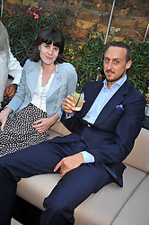 LADY LAURA CATHCART and RAIMONDO GAETANI LOVATELLI at the launch party of the new Embargo 59 nightclub at 533 Kings Road, London on 25th June 2009.