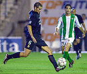 Photo Peter Spurrier<br /> 14/09/2002<br /> 2002 Real Betis vs Real Madrid  - Spanish Liga 1<br /> Madrid's Helguera with the ball is watched by Betis's Arzu