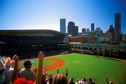 Stock photo of fans with a Houston skyline view cheering at an Astros game at Minute Maid Park