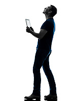 one  man holding digital tablet looking up in silhouette on white background