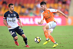 December 17, 2017 - Brisbane, QUEENSLAND, AUSTRALIA - Connor O'Toole of the Roar (24, right) controls the ball in front of Kosta Barbarouses of Melbourne Victory (9) during the round eleven Hyundai A-League match between the Brisbane Roar and the Melbourne Victory at Suncorp Stadium on Sunday, December 17, 2017 in Brisbane, Australia. (Credit Image: © Albert Perez via ZUMA Wire)