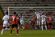 Shrewsbury Town Goalkeeper Harry Burgoyne punches clear during the EFL Sky Bet League 1 match between Lincoln City and Shrewsbury Town at Sincil Bank, Lincoln, United Kingdom on 15 December 2020.