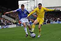 Photo:Tony Oudot/Richard Lane Photography. Peterborough United v Leeds United. Coca-Cola Football League One. 04/10/2008. Paul Coutts of Peterborough with Neil Kilkenny of Leeds.