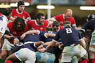 Adam Jones (l), Huw Bennett (c) and Paul James (r) pack down in the scrum. RBS Six nations, Wales v France at the Millennium Stadium in Cardiff on Friday 26th Feb 2010. pic by  Andrew Orchard , Andrew Orchard sports photography,