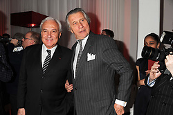 Left to right, BERNARD FORNAS Chief Executive of Cartier and ARNAUD BAMBERGER Executive Chairman Cartier UK at a reception to present the new Cartier Tank Watch Collection held at The Orangery, Kensington Palace Gardens, London W8 on 19th April 2012.