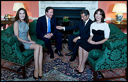 Prime Minister David Cameron and his wife Samantha in Number 10 Downing Street with The French President Nicolas Sarkozy and his wife Carla Bruni-Sarkozy, Friday June 18, 2010. Photo By Andrew Parsons / i-Images.<br /> File photo - French ex-President Nicolas Sarkozy has been detained for questioning over alleged influence peddling.<br /> Mr Sarkozy is being held at Nanterre, near Paris, in an unprecedented step against a former president. Photo filed Tuesday July 01 2014.