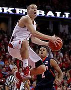 Wisconsin's Ben Brust shoots against Illinois' D.J. Richardson. (AP Photo/Andy Manis)