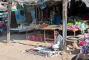 Selling fruit and repairing shoes on the street of Shahpura, Madhya Pradesh, India.