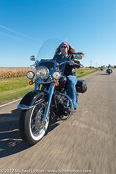 Michaela Glugla of Aberdeen, SD riding her Harley-Davidson Softail Deluxe in the USS South Dakota submarine flag relay near Groton as it crosses South Dakota. USA. Sunday October 8, 2017. Photography ©2017 Michael Lichter.