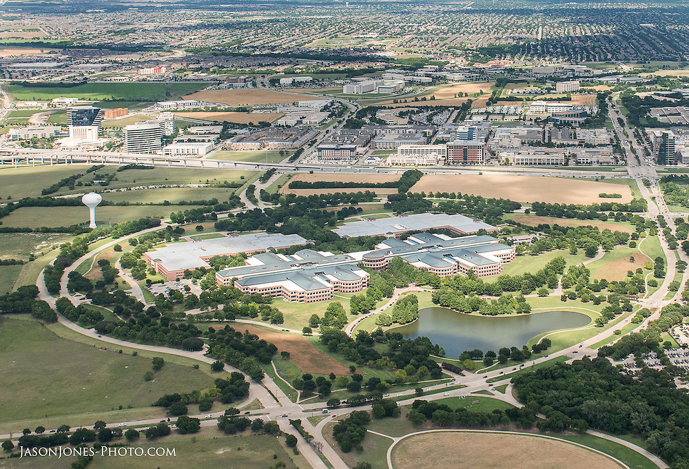 Aerial photography of a large industrial complex with surrounding access and landscape featured