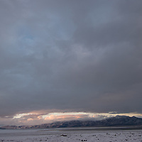 Clouds from a clearing winter storm swirl over Crowley Lake and the Glass Mountains,  east of the Sierra Nevada crest in California.