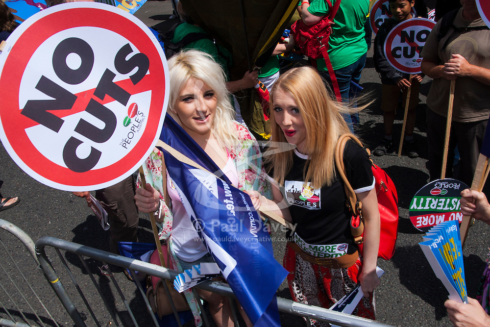 London, June 21st 2014. Two women prepare to march against austerity along with thousands of others, through London