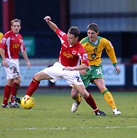 Photo: Dave Linney.<br />Walsall v Yeovil Town. The FA Cup. 03/12/2005.<br />  Carl Robinson(Norwich/right) keeps a close eye on Gary Roberts(Crewe/right)