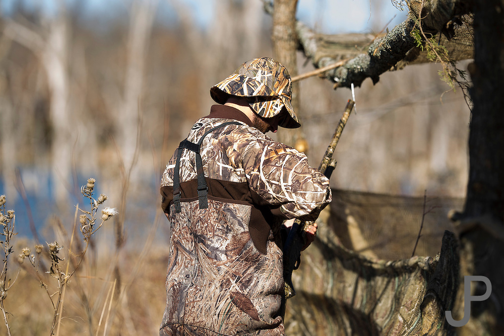 Vance Fielder works on a duck blind while hunting in Shamrock, Oklahoma