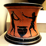 Black figured stand showing revellers Greek, made in Athens around 520-500 BC. Said to be from Vulci, Italy Stands like this were used to support pointed amphorae.