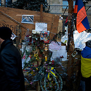 January 29, 2014 - Kiev, Ukraine: Anti-government protestors pass by a shrine dedicated to a protestor killed during clashes with the riot police early in the week. (Paulo Nunes dos Santos)