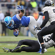 D.J. Johnson, Air Force, is tackled during the Army Black Knights Vs Air Force Falcons, College Football match at Michie Stadium, West Point. New York. Air Force won the game 23-6. West Point, New York, USA. 1st November 2014. Photo Tim Clayton