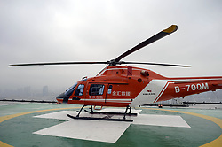 June 27, 2017 - Chongqin, Chongqin, China - Chongqing, CHINA-June 27 2017: (EDITORIAL USE ONLY. CHINA OUT)..The first helicopter ambulance lands on the roof of the Chongqing Ambulance Center in southwest China's Chongqing, June 27th, 2017, marking the official start of air medical service in Chongqing. (Credit Image: © SIPA Asia via ZUMA Wire)