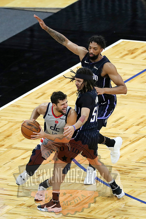 ORLANDO, FL - APRIL 07: Cole Anthony #50 of the Orlando Magic and Khem Birch #24 of the Orlando Magic press against Raul Neto #19 of the Washington Wizards during the first half at Amway Center on April 7, 2021 in Orlando, Florida. NOTE TO USER: User expressly acknowledges and agrees that, by downloading and or using this photograph, User is consenting to the terms and conditions of the Getty Images License Agreement. (Photo by Alex Menendez/Getty Images)*** Local Caption *** Cole Anthony; Khem Birch; Raul Neto