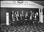 1980-02-29.29th February 1980.29/02/1980.02-29-80..Photographed at Burlington Hotel, Dublin..Sporting Prowess:..Ireland's Top Ten sporting figures from 1979 are acknowledged at the Texaco Sportstars of the Year Awards. .Centre of Back Row:..Cadet David Cummins, recipient of the Swimming Award...Front Row From Left:..First: John Treacey,  recipient of the Athletics Award.Third: George Colley TD who presented the awards .Fourth: Tony Hill, Managing Director of Texaco (Ireland) Limited.Fifth: Mike Sheehy, recipient of the Gaelic Football Award.