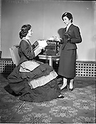 19/03/1958<br /> 03/19/1958<br /> 19 March 1958<br /> Remington reception, Office Efficiency exhibition at Royal Hibernian Hotel. Hostess in 'period ' costume with colleague in uniform.
