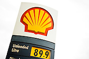 Shell petrol station sign advertising unleaded petrol at 89.9 pence per litre, Gloucestershire, UK