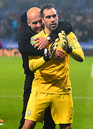 Manchester City Manager Pep Guardiola hugs Goalkeeper Claudio Bravo of Manchester City after he saves them in a penalty shootout from being knocked out of the Carabao Cup.Carabao Cup quarter final match, Leicester City v Manchester City at the King Power Stadium in Leicester, Leicestershire on Tuesday 19th December 2017.<br /> pic by Bradley Collyer, Andrew Orchard sports photography.
