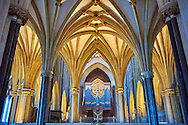 """The interior and organ of the medieval Wells Cathedral built in the Early English Gothic style in 1175, Wells Somerset, England . Its Gothic architecture is mostly in Early English style of the late 12th – early 13th centuries. Building began about 1175 at the east end with the choir. Historian John Harvey sees it as Europe's first truly Gothic structure. Its Early English front with 300 sculpted figures, is seen as a """"supreme triumph of the combined plastic arts in England"""".<br /> <br /> Visit our MEDIEVAL PHOTO COLLECTIONS for more   photos  to download or buy as prints https://funkystock.photoshelter.com/gallery-collection/Medieval-Middle-Ages-Historic-Places-Arcaeological-Sites-Pictures-Images-of/C0000B5ZA54_WD0s"""