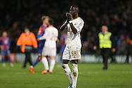 Modou Barrow of Swansea City applauding the Swansea City away fans after the final whistle.Barclays Premier League match, Crystal Palace v Swansea city at Selhurst Park in London on Monday 28th December 2015.<br /> pic by John Patrick Fletcher, Andrew Orchard sports photography.