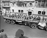 Coill Dubh Childrens Band   (F16)..1973..03.06.1973..06.03.1973..3rd June 1973..At The Fleadh Nua Parade in Dublin,Bord Na Mona sponsored Scoil Náisiúnta,Coill Dubh,CillDara,Childrens Band. The band comprised of 33 children was ferried through Dublin streets aboard the sponsors lorry..Image of the Bord Na Mona Lorry carrying the Coill Dubh Childrens band passing down O'Connell Street,Dublin in the Fleadh Nua Parade.