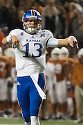 AUSTIN, TX - NOVEMBER 7:  Ryan Willis #13 of the Kansas Jayhawks celebrates after his teammate De'Andre Mann #23 rushed for a 1 yard touchdown against the Texas Longhorns during the 2nd quarter on November 7, 2015 at Darrell K Royal-Texas Memorial Stadium in Austin, Texas.  (Photo by Cooper Neill/Getty Images) *** Local Caption *** Ryan Willis
