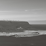 SvalSat, a satellite ground station located on Platåberget, and the Longyearbyen airport below.