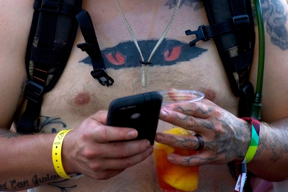 A reveler uses a smartphone during the Firefly Music Festival in Dover, Delaware U.S., June 14, 2018.  REUTERS/Mark Makela