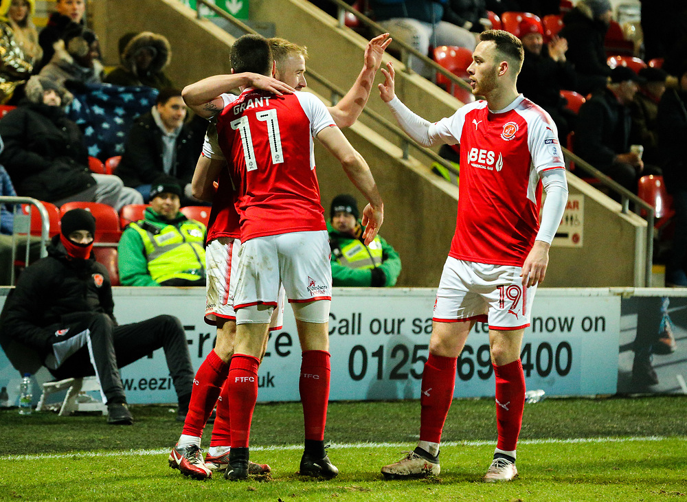 Fleetwood Town's Paddy Madden celebrates scoring his side's equalising goal with Bobby Grant and Gethin Jones<br /> <br /> Photographer Alex Dodd/CameraSport<br /> <br /> The EFL Sky Bet League One - Fleetwood Town v Shrewsbury Town - Tuesday 13th February 2018 - Highbury Stadium - Fleetwood<br /> <br /> World Copyright © 2018 CameraSport. All rights reserved. 43 Linden Ave. Countesthorpe. Leicester. England. LE8 5PG - Tel: +44 (0) 116 277 4147 - admin@camerasport.com - www.camerasport.com