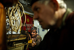 Greek engineers Konstantinos Komninakis  and Giorgos Diakatos work on the Alfa K, a Mediterranean based bulk carrier with a Panamanian flag, as it undergoes repairs at the port of Piraeus in Greece on Feb. 20, 2008. Inspectors impose ITF-standard treaties on ship-owners to guarantee minimal standard working conditions for seafarers. They are on call 24 hours a day to address concerns from workers coming to port on the international ships.