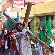A religious re-enactment of the Crucifiction of Jesus Christ as a parade works it's way through the back streets of La Paz, Bolivia, April 02, 2010. Photo Tim Clayton