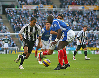 Photo: Andrew Unwin.<br /> Newcastle United v Portsmouth. The Barclays Premiership. 26/11/2006.<br /> Newcastle's Kieron Dyer (L) leads an attack as he returns to the starting line-up.