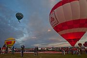 State Farm Insurance Balloon. Albuquerque Balloon Fiesta, New Mexico. Mass assencion on Sunday morning at dawn of 500 hot air balloons.