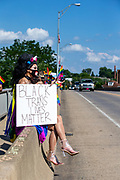 """Mandy holds a sign reading """"Black trans lives matter"""" during the Milton Pride Rally in Milton, Pennsylvania on August 8, 2020. The I Am Alliance organized the event to show support for the LGBTQ community. (Photo by Paul Weaver)"""