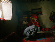Evening prayer time at Haji Osman's house..Campment of Tshar Tash (Haji Osman's camp), in the Wakhjir valley, at the source of the Oxus..Winter expedition through the Wakhan Corridor and into the Afghan Pamir mountains, to document the life of the Afghan Kyrgyz tribe. January/February 2008. Afghanistan