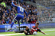 Cardiff City's Anthony Pilkington (13) is tackled by QPR's Grant Hill. Skybet football league championship match, Cardiff city v Queens Park Rangers at the Cardiff city stadium in Cardiff, South Wales on Saturday 16th April 2016.<br /> pic by Carl Robertson, Andrew Orchard sports photography.