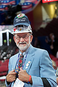 A GOP delegate wears several hats decorated with campaign buttons during the Republican National Convention July 20, 2016 in Cleveland, Ohio.