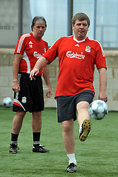 LIVERPOOL, ENGLAND - Tuesday, May 12, 2009: Ex-Liverpool players Jan Molby and Mark Lawrenson during a training session at Melwood as the players prepare for the Hillsborough Memorial Game in aid of the Marina Dalglish Appeal which will be staged at Anfield on May 14. (Photo by Dave Kendall/Propaganda)